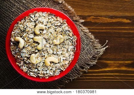 Oatmeal With Nuts Cashew. Oatmeal On A Wooden Table. Oatmeal Top View. Healthy Food