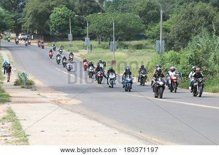 Long Line Of Motorbikes Travelling Through City Streets