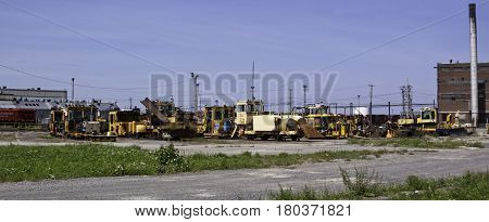 Montreal, Quebec, August 20, 2016 - Panoramic view of an old railroad bone yard with a variety of work vehicles and parts in the CP Rail Train Yards in Cote Saint Luc in Montreal Quebec on a sunny day in August.