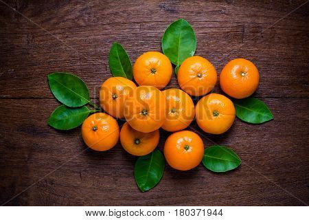 Fresh orange fruits on table. Top view