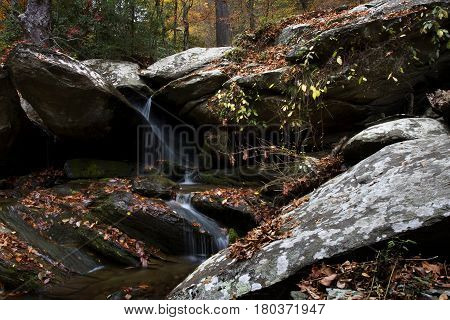 Water flows over rocks and boulders during autumn near Ocoee, Tennessee