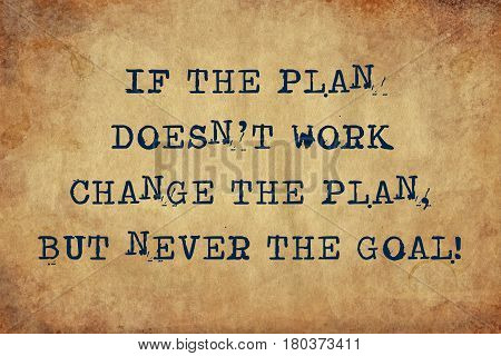 Inspiring motivation quote with typewriter text if the plan doesn't work, change the plan but never the goal. Distressed Old Paper with Typing image.