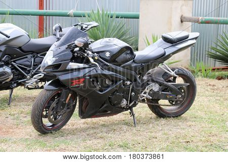 Parked Black Suzuki Gsxr 1000 Cc Motorbike On Green Grass