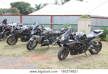 Row Of Black Parked Motorbikes At Yearly Mass Ride