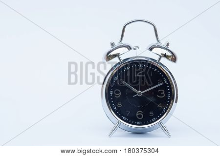 Alarm clock isolated on white background, stock photo