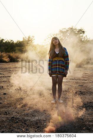 Woman Enjoy Color Smoke Bomb Outdoors