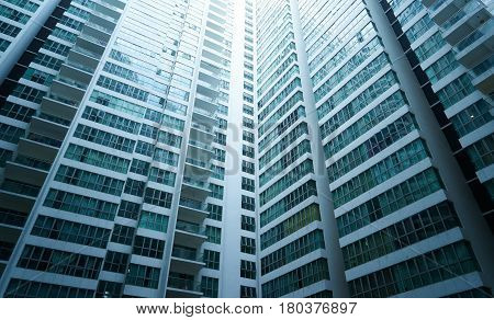 Apartment building.Multistoried modern and stylish living block of flats. Real estate and new house.