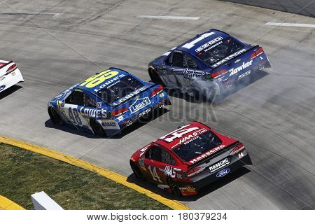 April 02, 2017 - Martinsville, Virginia, USA: Jimmie Johnson (48), Jamie McMurray (1) and Clint Bowyer (14) battle for position during the STP 500 at Martinsville Speedway in Martinsville, Virginia.