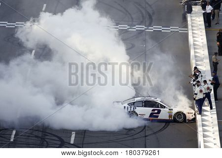April 02, 2017 - Martinsville, Virginia, USA: Brad Keselowski (2) celebrates by doing a burnout on the front stretch after winning the STP 500 at Martinsville Speedway in Martinsville, Virginia.