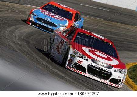April 02, 2017 - Martinsville, Virginia, USA: Kyle Larson (42) leads a pack of cars during the STP 500 at Martinsville Speedway in Martinsville, Virginia.