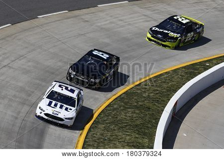 April 02, 2017 - Martinsville, Virginia, USA: Brad Keselowski (2) leads Reed Sorenson (15) and Joey Logano (22) during the STP 500 at Martinsville Speedway in Martinsville, Virginia.