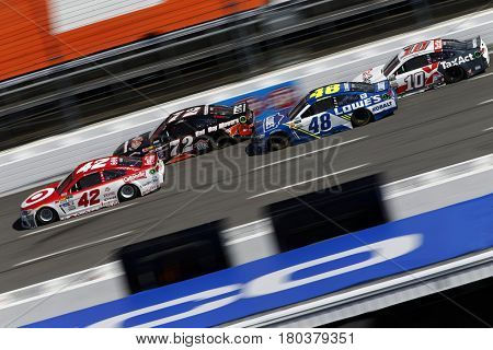 April 02, 2017 - Martinsville, Virginia, USA: Kyle Larson, Cole Whitt, Jimmie Johnson, Danica Patrick battle for position during the STP 500 at Martinsville Speedway in Martinsville, Virginia.