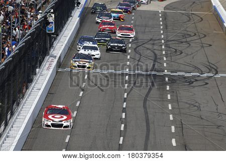 April 02, 2017 - Martinsville, Virginia, USA: Kyle Larson (42) leads the field to turn one during the STP 500 at Martinsville Speedway in Martinsville, Virginia.