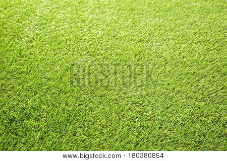Perfectely green artificial turf as a bakground.