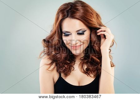 Pretty Redhead Woman with Makeup and Permed Hairstyle