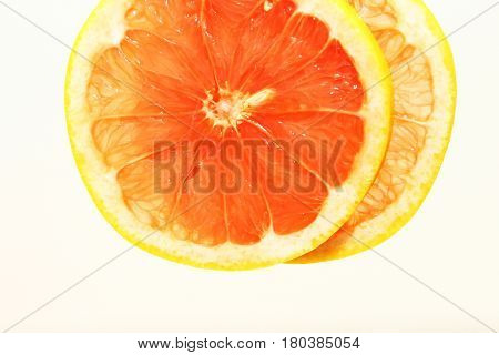 Grapefruit background / The grapefruit is a subtropical citrus tree known for its sour to semi-sweet fruit.
