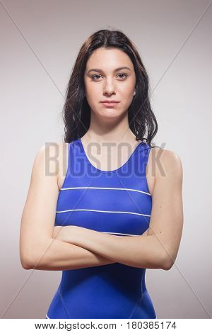 One Young Woman Swimmer Swimsuit, Serious Expression