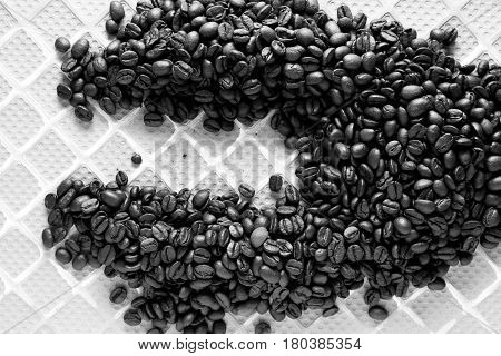 Coffee Beans close up shot / Roasting coffee transforms the chemical and physical properties of green coffee beans into roasted coffee products