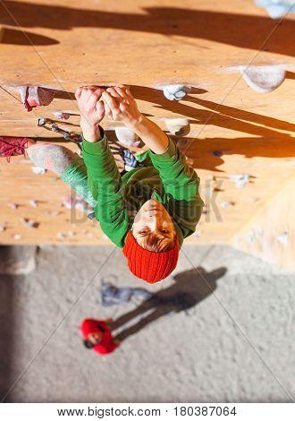 The Girl Climbs On The Climbing Wall.