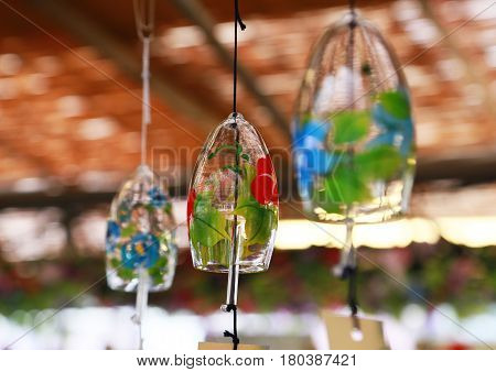 A spectacle of Japanese glass wind chimes hanging on the ceiling