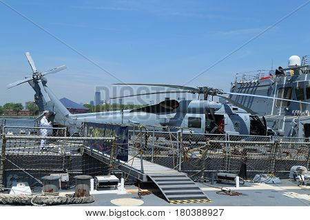 NEW YORK - MAY 26, 2016: Sikorsky MH-60R Seahawk helicopter on the deck of US guided missile destroyer USS Bainbridge during Fleet Week 2016 in New York