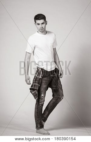 stylish young brunet in white t-shirt and jeans