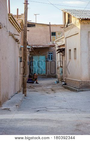 Woman Sitting At The Street In Khiva Old Town