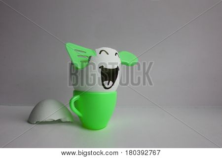 Egg with face. The concept of laughter prolongs life. Photo for your design