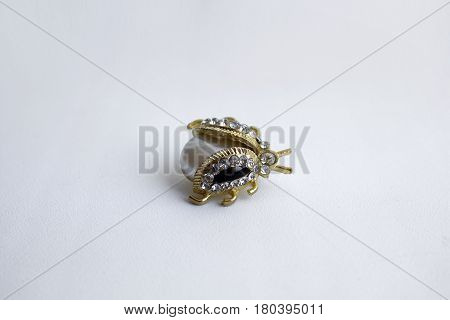 Gilt brooch in the form of a beetle with a pearl and small semiprecious stones