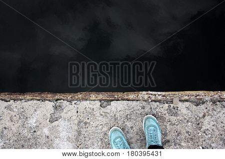 man stands on the edge of a precipice