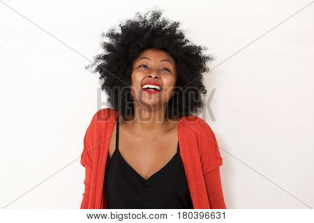 Young African Woman Laughing By White Wall