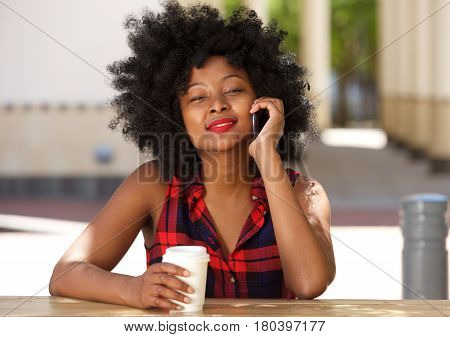Happy Woman Talking With Smart Phone At Outside Cafe