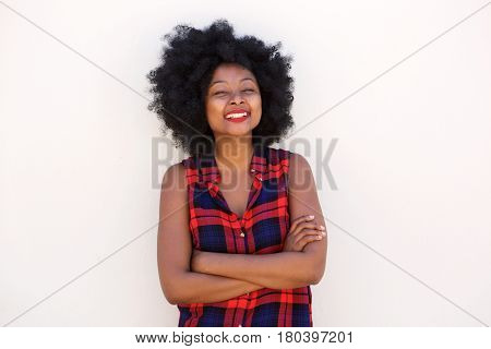 Happy Laughing Woman With Arms Crossed By White Wall