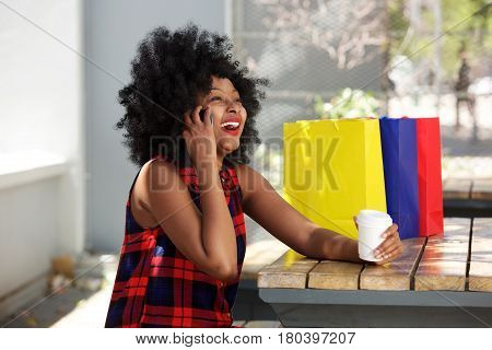 Happy Woman On Cellphone With Coffee And Shopping Bags