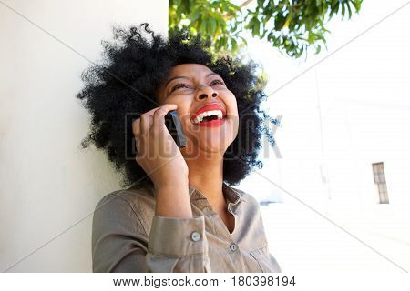 Laughing Woman Talking On Smart Phone Outside