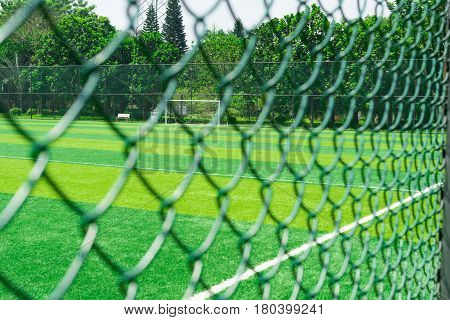 a soccer field behind the fence horizontal