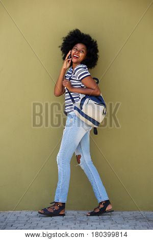Full Length Happy Woman Walking With Bag And Smart Phone