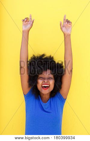 Beautiful Woman Smiling With Arms Raised