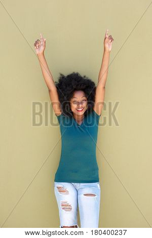 Cheerful Black Woman Smiling With Outstretched Arms