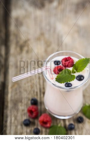 Smoothies Or Yogurt With Fresh Berries On A Wooden Table.