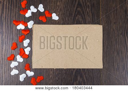 Red And White Hearts And Card On A Dark Wooden Background.