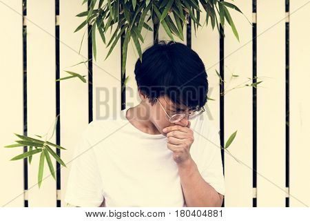 Young asian man sick unwell fever
