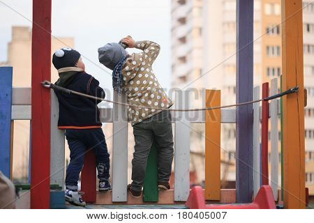 GOMEL, BELARUS - 6 April 2017: unfamiliar children play on the playground in early spring