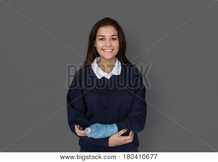 Young Student in Uniform with Broken Arm Studio Portrait