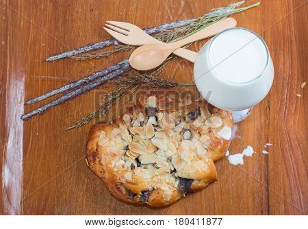 muffins and Milk in glass isolated on wooden table