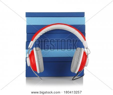 Audiobook concept. Stack of books and headphones on white background