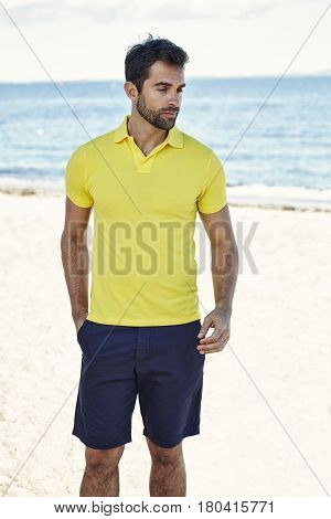 Guy in yellow shirt on beach content