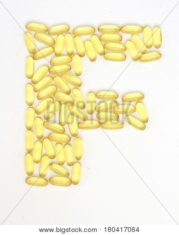 the letter F made from Fish oil caps