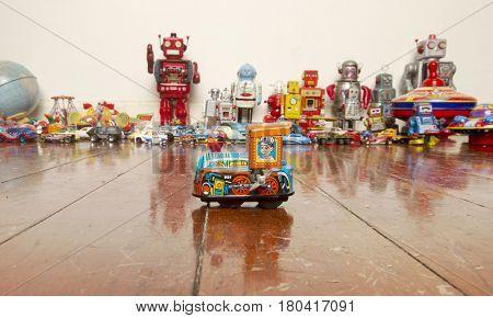 small  tin toy train on wooden floor