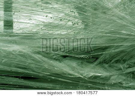 Green Color Plastic Wrap Surface.